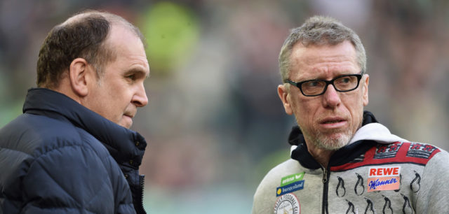WOLFSBURG, GERMANY - JANUARY 31: Peter Stoeger head coach of Cologne (R) in discussion with Joerg Schmadtke athletic director of Colonge prior to the Bundesliga match between VfL Wolfsburg and 1. FC Koeln at Volkswagen Arena on January 31, 2016 in Wolfsburg, Germany. (Photo by Stuart Franklin/Bongarts/Getty Images)