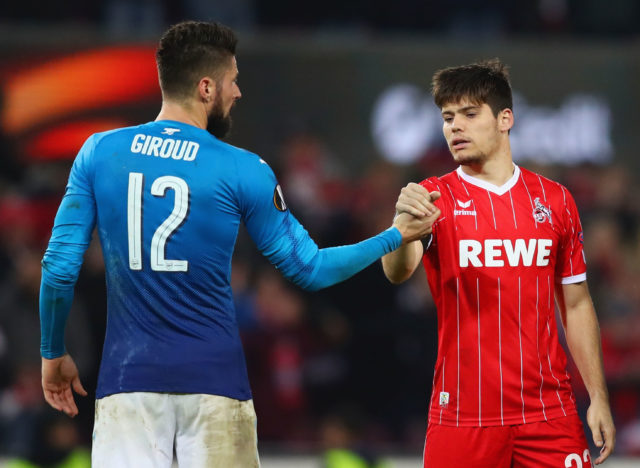 COLOGNE, GERMANY - NOVEMBER 23: Olivier Giroud of Arsenal and Jorge Mere of FC Koeln shake hands after the UEFA Europa League group H match between 1. FC Koeln and Arsenal FC at RheinEnergieStadion on November 23, 2017 in Cologne, Germany. (Photo by Dean Mouhtaropoulos/Getty Images)