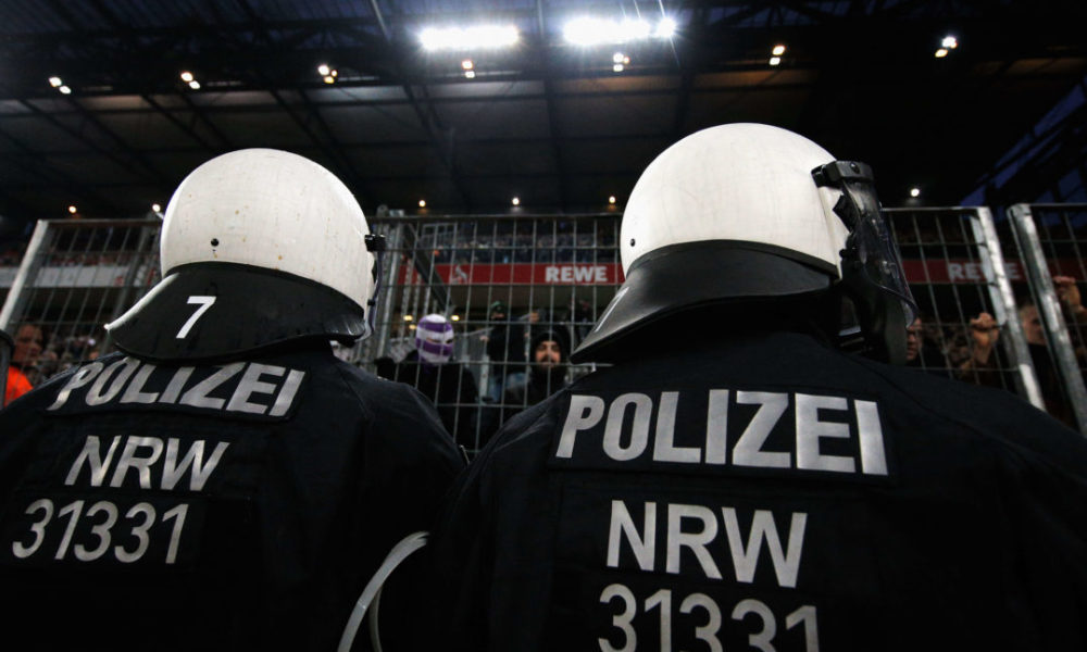 COLOGNE, GERMANY - JANUARY 14: Police or Polizei watch the fans of Borussia Monchengladbach during the Bundesliga match between 1. FC Koeln and Borussia Moenchengladbach at RheinEnergieStadion on January 14, 2018 in Cologne, Germany. (Photo by Dean Mouhtaropoulos/Bongarts/Getty Images)
