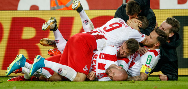 COLOGNE, GERMANY - JANUARY 14: Simon Terodde of Koeln celebrates with team mates after scoring his teams winning goal during the Bundesliga match between 1. FC Koeln and Borussia Moenchengladbach at RheinEnergieStadion on January 14, 2018 in Cologne, Germany. (Photo by Lars Baron/Bongarts/Getty Images)