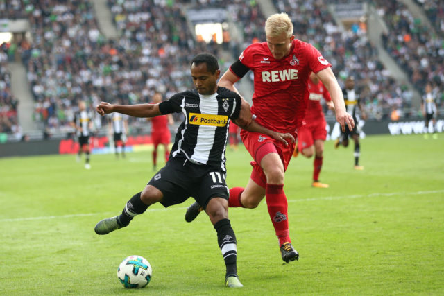MOENCHENGLADBACH, GERMANY - AUGUST 20: Raffael of Moenchengladbach (l) and Frederik Sorensen of Koeln during the Bundesliga match between Borussia Moenchengladbach and 1. FC Koeln at Borussia-Park on August 20, 2017 in Moenchengladbach, Germany. (Photo by Christof Koepsel/Bongarts/Getty Images)