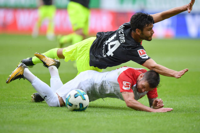 AUGSBURG, GERMANY - SEPTEMBER 09: Jonas Hector of Koeln fouls Marcel Heller of Augsburg in the penalty box during the Bundesliga match between FC Augsburg and 1. FC Koeln at WWK-Arena on September 9, 2017 in Augsburg, Germany. (Photo by Sebastian Widmann/Bongarts/Getty Images)