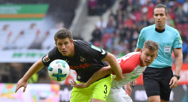 AUGSBURG, GERMANY - SEPTEMBER 09: Dominique Heintz of Koeln and Alfred Finnbogason of Augsburg compete for the ball during the Bundesliga match between FC Augsburg and 1. FC Koeln at WWK-Arena on September 9, 2017 in Augsburg, Germany. (Photo by Sebastian Widmann/Bongarts/Getty Images)