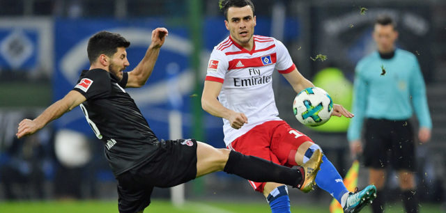HAMBURG, GERMANY - JANUARY 20: Filip Kostic of Hamburg (r) fights for the ball with Milos Jojic of Koeln during the Bundesliga match between Hamburger SV and 1. FC Koeln at Volksparkstadion on January 20, 2018 in Hamburg, Germany. (Photo by Stuart Franklin/Bongarts/Getty Images)