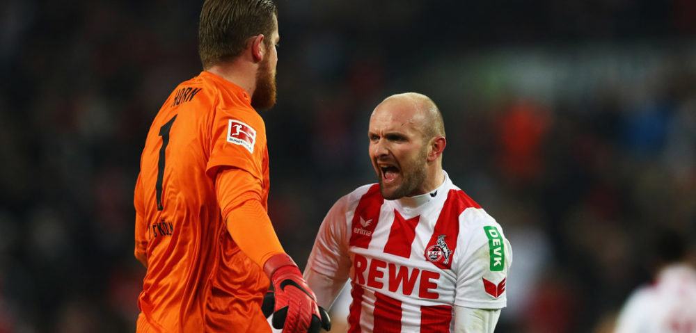 COLOGNE, GERMANY - JANUARY 14: Goalkeeper, Timo Horn and Konstantin Rausch of FC Koeln celebrate victory after the Bundesliga match between 1. FC Koeln and Borussia Moenchengladbach at RheinEnergieStadion on January 14, 2018 in Cologne, Germany. (Photo by Dean Mouhtaropoulos/Bongarts/Getty Images)
