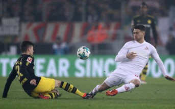 COLOGNE, GERMANY - FEBRUARY 02: Julian Weigl of Dortmund is challenged by Salih Ozcan of Cologne during the Bundesliga match between 1. FC Koeln and Borussia Dortmund at RheinEnergieStadion on February 2, 2018 in Cologne, Germany. (Photo by Alex Grimm/Bongarts/Getty Images)