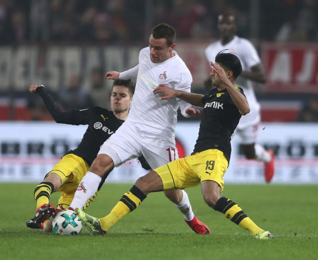 COLOGNE, GERMANY - FEBRUARY 02: Christian Clemens of Cologne is challenged by Julian Weigl and Mahmoud Dahoud of Dortmund during the Bundesliga match between 1. FC Koeln and Borussia Dortmund at RheinEnergieStadion on February 2, 2018 in Cologne, Germany. (Photo by Alex Grimm/Bongarts/Getty Images)
