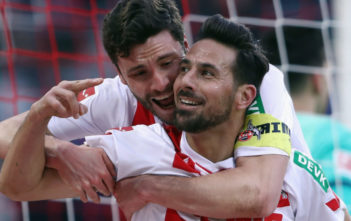 COLOGNE, GERMANY - FEBRUARY 17: Claudio Pizarro of Koeln celebrates his goal with team mate Jonas Hector before referee Markus Schmidt takes it back because of offside during the Bundesliga match between 1. FC Koeln and Hannover 96 at RheinEnergieStadion on February 17, 2018 in Cologne, Germany. (Photo by Alex Grimm/Bongarts/Getty Images)