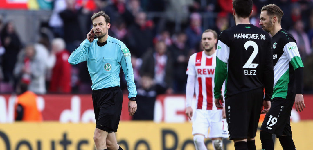 COLOGNE, GERMANY - FEBRUARY 17: Referee Markus Schmidt listens to the video assistant referee VAR on his headphone during the Bundesliga match between 1. FC Koeln and Hannover 96 at RheinEnergieStadion on February 17, 2018 in Cologne, Germany. (Photo by Alex Grimm/Bongarts/Getty Images)