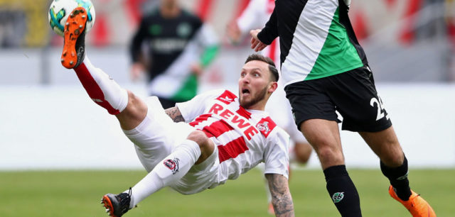 COLOGNE, GERMANY - FEBRUARY 17: Marco Hoeger (L) of Koeln is challenged by Niclas Fuellkrug of Hannover during the Bundesliga match between 1. FC Koeln and Hannover 96 at RheinEnergieStadion on February 17, 2018 in Cologne, Germany. (Photo by Alex Grimm/Bongarts/Getty Images)