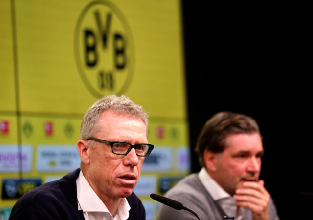 DORTMUND, GERMANY - DECEMBER 10: (L-R) New hed coach Peter Stoeger and manager Michael Zorc of Dortmund during the press conference at Signal Iduna Park on December 10, 2017 in Dortmund, Germany. (Photo by Christof Koepsel/Bongarts/Getty Images)