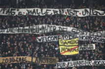 Fans protest against scheduling football games on mondays (Montagsspiele) during the German First division Bundesliga football match Eintracht Frankfurt vs RB Leipzig in Frankfurt, Germany, on February 19, 2018. / AFP PHOTO / Daniel ROLAND / RESTRICTIONS: DURING MATCH TIME: DFL RULES TO LIMIT THE ONLINE USAGE TO 15 PICTURES PER MATCH AND FORBID IMAGE SEQUENCES TO SIMULATE VIDEO. == RESTRICTED TO EDITORIAL USE == FOR FURTHER QUERIES PLEASE CONTACT DFL DIRECTLY AT + 49 69 650050 (Photo credit should read DANIEL ROLAND/AFP/Getty Images)
