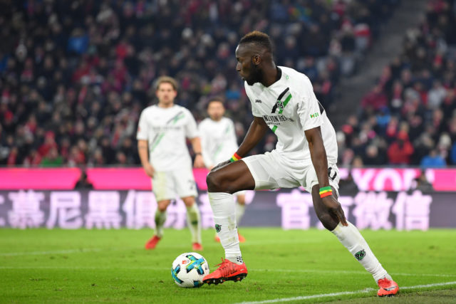 MUNICH, GERMANY - DECEMBER 02: Salif Sane of Hannover plays the ball during the Bundesliga match between FC Bayern Muenchen and Hannover 96 at Allianz Arena on December 2, 2017 in Munich, Germany.