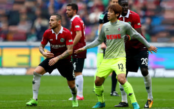 HANOVER, GERMANY - SEPTEMBER 24: Yuya Osako #13 of Koeln battle in action during the Bundesliga match between Hannover 96 and 1. FC Koeln at HDI-Arena on September 24, 2017 in Hanover, Germany. (Photo by Martin Rose/Bongarts/Getty Images)