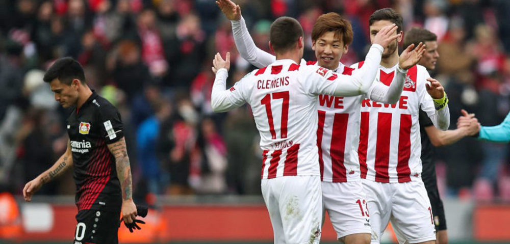 COLOGNE, GERMANY - MARCH 18: Yuya Osako #13 of 1.FC Koeln and Christian Clemens #17 of 1.FC Koeln celebrate after the Bundesliga match between 1. FC Koeln and Bayer 04 Leverkusen at RheinEnergieStadion on March 18, 2018 in Cologne, Germany. (Photo by Maja Hitij/Bongarts/Getty Images)