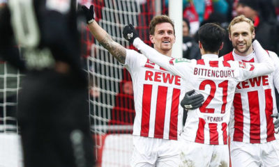 COLOGNE, GERMANY - MARCH 18: Simon Zoller #11 of 1.FC Koeln celebrates with Leonardo Bittencourt #21 of 1.FC Koeln and Marcel Risse #7 of 1.FC Koeln after scoring his teams second goal during the Bundesliga match between 1. FC Koeln and Bayer 04 Leverkusen at RheinEnergieStadion on March 18, 2018 in Cologne, Germany. (Photo by Maja Hitij/Bongarts/Getty Images)