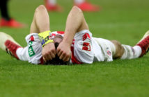 COLOGNE, GERMANY - MARCH 04: Jonas Hector of Koeln lies on the pitch after losing 2-3 the Bundesliga match between 1. FC Koeln and VfB Stuttgart at RheinEnergieStadion on March 4, 2018 in Cologne, Germany. (Photo by Christof Koepsel/Bongarts/Getty Images)