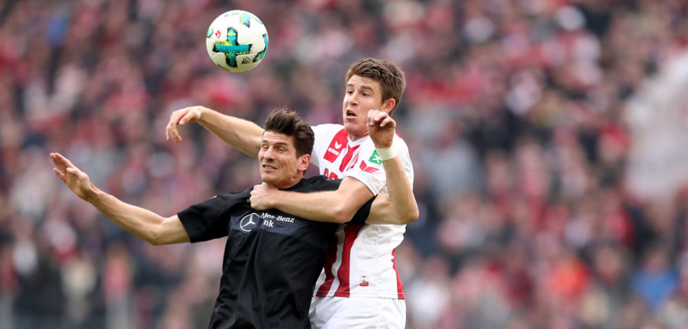 COLOGNE, GERMANY - MARCH 04: (L-R) Mario Gomez of Stuttgart and Frederik Soerensen of Koeln go up for a header during the Bundesliga match between 1. FC Koeln and VfB Stuttgart at RheinEnergieStadion on March 4, 2018 in Cologne, Germany. (Photo by Christof Koepsel/Bongarts/Getty Images)