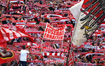 Cologne´s supporters celebrate during the German first division Bundesliga football match between FC Cologne and FC Ingolstadt 04, in Cologne, western Germany, on October 15, 2016. / AFP / PATRIK STOLLARZ / RESTRICTIONS: DURING MATCH TIME: DFL RULES TO LIMIT THE ONLINE USAGE TO 15 PICTURES PER MATCH AND FORBID IMAGE SEQUENCES TO SIMULATE VIDEO. == RESTRICTED TO EDITORIAL USE == FOR FURTHER QUERIES PLEASE CONTACT DFL DIRECTLY AT + 49 69 650050 (Photo credit should read PATRIK STOLLARZ/AFP/Getty Images)