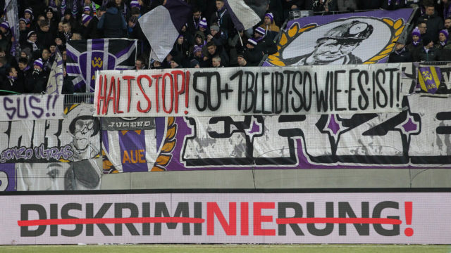 AUE, GERMANY - MARCH 19: Fans of Aue with banner Halt Stop! 50+1 bleibt so wie es ist during the second Bundesliga match between FC Erzgebirge Aue and SpVgg Greuther Fuerth at Sparkassen-Erzgebirgsstadion on March 19, 2018 in Aue, Germany. (Photo by Karina Hessland-Wissel/Bongarts/Getty Images)