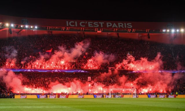 PARIS, FRANCE - MARCH 06: PSG fans light flares during the UEFA Champions League Round of 16 Second Leg match between Paris Saint-Germain and Real Madrid at Parc des Princes on March 6, 2018 in Paris, France. (Photo by Matthias Hangst/Bongarts/Getty Images)