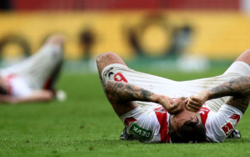 COLOGNE, GERMANY - APRIL 22: Marco Hoeger of Koeln lies dejected on the pitch after the Bundesliga match between 1. FC Koeln and FC Schalke 04 at RheinEnergieStadion on April 22, 2018 in Cologne, Germany. (Photo by Maja Hitij/Bongarts/Getty Images)