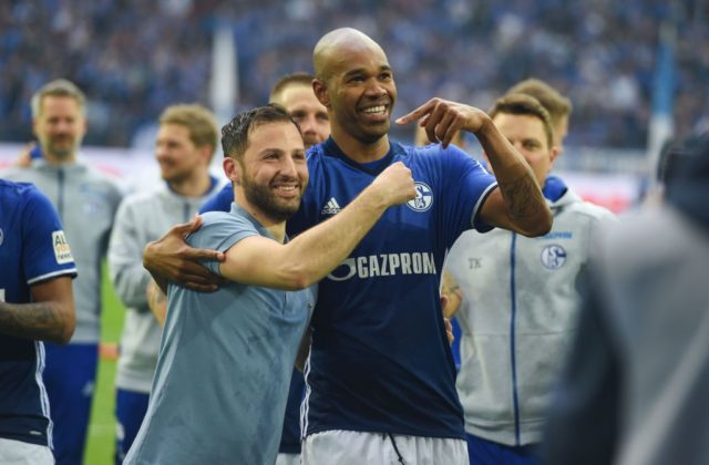 Schalke's German headcoach Domenico Tedesco and Schalke's Brazilian defender Naldo celebrate celebrate after the German first division Bundesliga football match FC Schalke 04 vs Borussia Dortmund, in Gelsenkirchen, western Germany, on April 15, 2018. / AFP PHOTO / Patrik STOLLARZ / RESTRICTIONS: DURING MATCH TIME: DFL RULES TO LIMIT THE ONLINE USAGE TO 15 PICTURES PER MATCH AND FORBID IMAGE SEQUENCES TO SIMULATE VIDEO. == RESTRICTED TO EDITORIAL USE == FOR FURTHER QUERIES PLEASE CONTACT DFL DIRECTLY AT + 49 69 650050 (Photo credit should read PATRIK STOLLARZ/AFP/Getty Images)