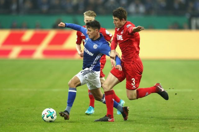 GELSENKIRCHEN, GERMANY - DECEMBER 19: Alessandro Schoepf (C) of Schalke battles for the ball with Dominique Heintz (R) of Koeln during the DFB Cup match between FC Schalke 04 and 1.FC Koeln at Veltins-Arena on December 19, 2017 in Gelsenkirchen, Germany. (Photo by Lars Baron/Bongarts/Getty Images)