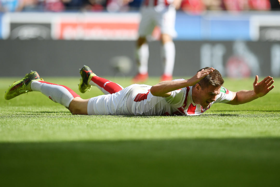 COLOGNE, GERMANY - APRIL 07: Simon Terodde of Koeln lies on the pitch and looks dejected during the Bundesliga match between 1. FC Koeln and 1. FSV Mainz 05 at RheinEnergieStadion on April 7, 2018 in Cologne, Germany. (Photo by Matthias Hangst/Bongarts/Getty Images)