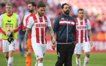 COLOGNE, GERMANY - APRIL 07: Marco Hoeger of Koeln (l) and Stefan Ruthenbeck, coach of Koeln, (c) looks dejected after the Bundesliga match between 1. FC Koeln and 1. FSV Mainz 05 at RheinEnergieStadion on April 7, 2018 in Cologne, Germany. (Photo by Matthias Hangst/Bongarts/Getty Images)