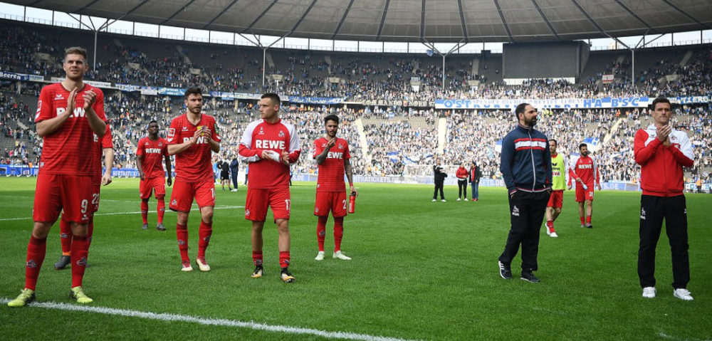 BERLIN, GERMANY - APRIL 14: Stefan Ruthenbeck, coach of Koeln, (2nd right) and players of Koeln applaud their supporters after the Bundesliga match between Hertha BSC and 1. FC Koeln at Olympiastadion on April 14, 2018 in Berlin, Germany. (Photo by Stuart Franklin/Bongarts/Getty Images)