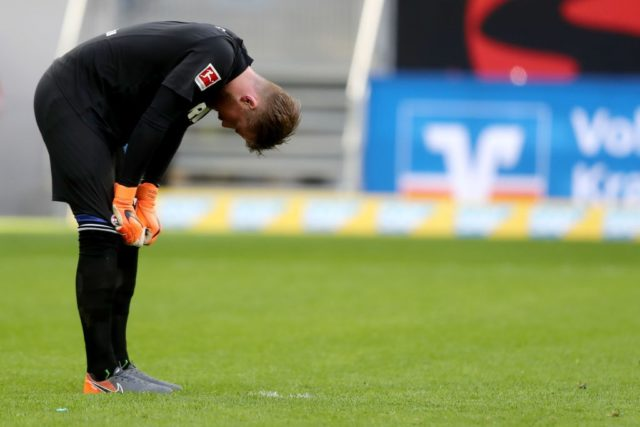 SINSHEIM, GERMANY - MARCH 31: Timo Horn of Koeln looks dejected after the sixth goal of Hoffenheim during the Bundesliga match between TSG 1899 Hoffenheim and 1. FC Koeln at Wirsol Rhein-Neckar-Arena on March 31, 2018 in Sinsheim, Germany.