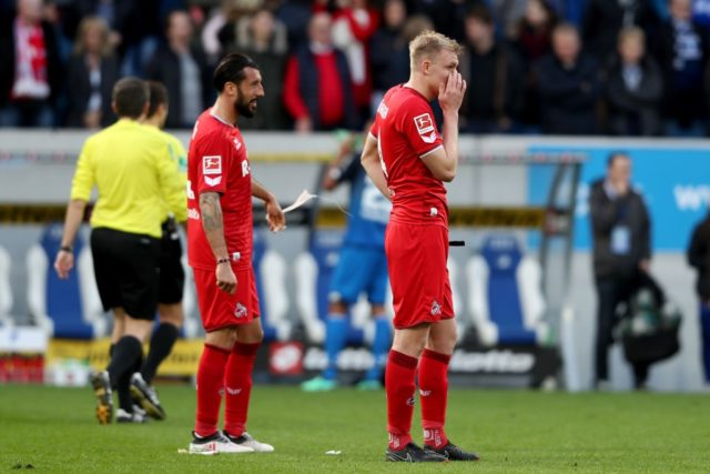 SINSHEIM, GERMANY - MARCH 31: (L-R) Dominic Maroh and Frederik Soerensen of Koeln look dejected after the Bundesliga match between TSG 1899 Hoffenheim and 1. FC Koeln at Wirsol Rhein-Neckar-Arena on March 31, 2018 in Sinsheim, Germany. The match between Hoffenheim and Koeln ended 6-0.