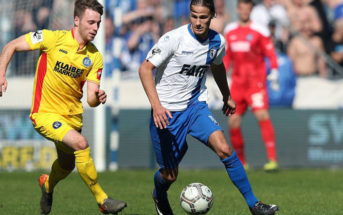 MAGDEBURG, GERMANY - APRIL 07: Matthias Bader (L) of Karlsruher SC and Tobias Schwede (R) of 1. FC Magdeburg compete during the 3. Liga match between 1. FC Magdeburg and Karlsruher SC at MDCC-Arena on April 7, 2018 in Magdeburg, Germany. (Photo by Ronny Hartmann/Bongarts/Getty Images)