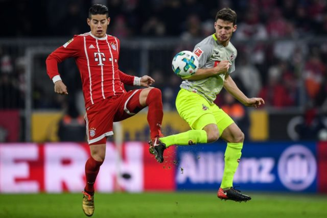 MUNICH, GERMANY - DECEMBER 13: James Rodriguez #11 of Bayern Munich (L) and Salih Oezcan #20 of 1.FC Koeln battle for the ball during the Bundesliga match between FC Bayern Muenchen and 1. FC Koeln at Allianz Arena on December 13, 2017 in Munich, Germany. (Photo by Matthias Hangst/Bongarts/Getty Images)