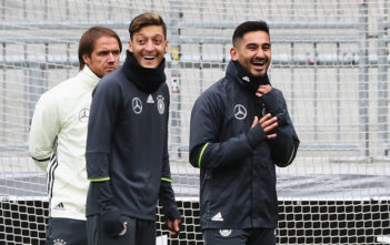 HAMBURG, GERMANY - OCTOBER 06: Ilkay Guendogan (2ndR) of Germany laughs with Mesut Oezil during a training session at Millerntor Stadion on October 6, 2016 in Hamburg, Germany. (Photo by Martin Rose/Bongarts/Getty Images)