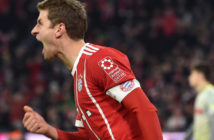 Bayern Munich's striker Thomas Mueller celebrates after the first goal during the German first division Bundesliga football match between FC Bayern Munich and FC Cologne on December 13, 2017 in Munich. / AFP PHOTO / Christof STACHE / RESTRICTIONS: DURING MATCH TIME: DFL RULES TO LIMIT THE ONLINE USAGE TO 15 PICTURES PER MATCH AND FORBID IMAGE SEQUENCES TO SIMULATE VIDEO. == RESTRICTED TO EDITORIAL USE == FOR FURTHER QUERIES PLEASE CONTACT DFL DIRECTLY AT + 49 69 650050 (Photo credit should read CHRISTOF STACHE/AFP/Getty Images)