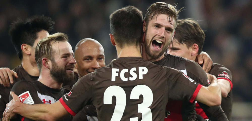 HAMBURG, GERMANY - DECEMBER 18: Lasse Sobiech (R) of Pauli celebrate after his first goal during the Second Bundesliga match between FC St. Pauli and VfL Bochum 1848 at Millerntor Stadium on December 18, 2017 in Hamburg, Germany. (Photo by Oliver Hardt/Bongarts/Getty Images)