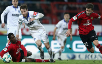 KARLSRUHE, GERMANY - MARCH 07: Matthias Bader (C) of Karlsruhe is challenged by Makana Baku (L) and Daniel Hagele of Grossaspach during the 3. Liga match between Karlsruher SC and SG Sonnenhof Grossaspach at Wildparkstadion on March 7, 2018 in Karlsruhe, Germany. (Photo by Alex Grimm/Bongarts/Getty Images)