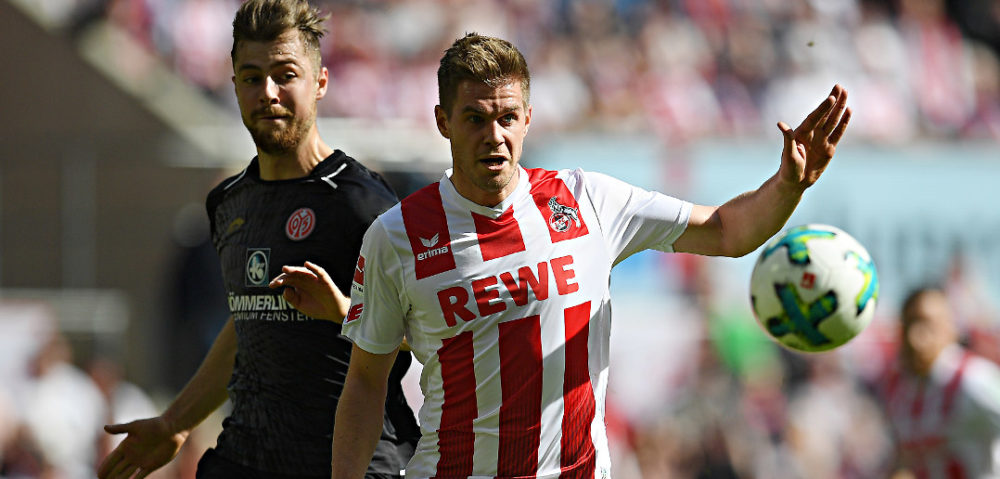 COLOGNE, GERMANY - APRIL 07: Simon Terodde of Stuttgart (r) runs for the ball with Alexander Hack of Mainz during the Bundesliga match between 1. FC Koeln and 1. FSV Mainz 05 at RheinEnergieStadion on April 7, 2018 in Cologne, Germany. (Photo by Matthias Hangst/Bongarts/Getty Images)