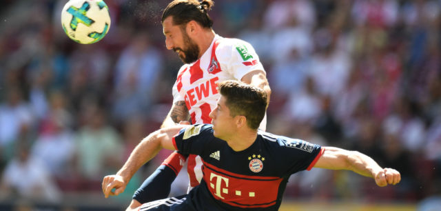 Bayern Munich's Polish forward Robert Lewandowski (bottom) and Cologne's Slovenian defender Dominic Maroh (top, L) vie for the ball during the German first division Bundesliga football match FC Cologne vs FC Bayern Munich in Cologne, western Germany, on May 5, 2018. (Photo by Patrik STOLLARZ / AFP) / RESTRICTIONS: DURING MATCH TIME: DFL RULES TO LIMIT THE ONLINE USAGE TO 15 PICTURES PER MATCH AND FORBID IMAGE SEQUENCES TO SIMULATE VIDEO. == RESTRICTED TO EDITORIAL USE == FOR FURTHER QUERIES PLEASE CONTACT DFL DIRECTLY AT + 49 69 650050 (Photo credit should read PATRIK STOLLARZ/AFP/Getty Images)