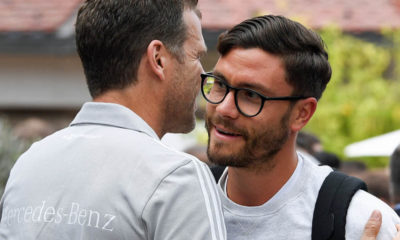 EPPAN, ITALY - MAY 23: (L-R) Team manager Oliver Bierhoff greets Jonas Hector as he arrives on day one of the Germany National Football team's training camp at Hotel Weinegg on May 23, 2018 in Eppan, Italy. (Photo by Markus Gilliar/DFB - Pool/Getty Images)