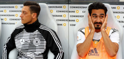 LEVERKUSEN, GERMANY - JUNE 08: Mesut Oezil (L) of Germany and team mate Ilkay Guendogan sitting on the bench during the International Friendly match between Germany and Saudi Arabia at BayArena on June 8, 2018 in Leverkusen, Germany. (Photo by Martin Rose/Bongarts/Getty Images)