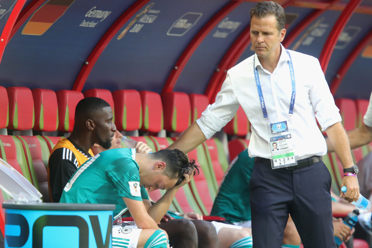 KAZAN, RUSSIA - JUNE 27: Oliver Bierhoff, team manager of Germany and his player Mesut Oezil look dejected after the 2018 FIFA World Cup Russia group F match between Korea Republic and Germany at Kazan Arena on June 27, 2018 in Kazan, Russia. (Photo by Alexander Hassenstein/Getty Images, )