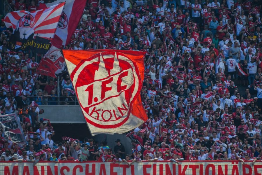 Cologne supporter wave flags during the German first division Bundesliga football match FC Cologne vs FC Bayern Munich in Cologne, western Germany, on May 5, 2018. (Photo by Patrik STOLLARZ / AFP) / RESTRICTIONS: DURING MATCH TIME: DFL RULES TO LIMIT THE ONLINE USAGE TO 15 PICTURES PER MATCH AND FORBID IMAGE SEQUENCES TO SIMULATE VIDEO. == RESTRICTED TO EDITORIAL USE == FOR FURTHER QUERIES PLEASE CONTACT DFL DIRECTLY AT + 49 69 650050 (Photo credit should read PATRIK STOLLARZ/AFP/Getty Images)