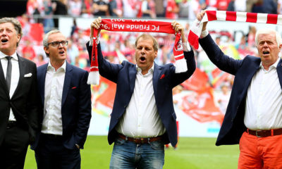 COLOGNE, GERMANY - MAY 23: (L-R) Toni Shcumacher, vice-president, chairman Alexander Wehrle, Markus Ritterbach, vice-president of Koeln and president Werner Spinner of Kolen sing the anthem prior to the Bundesliga match between 1. FC Koelan and VfL Wolfsburg at RheinEnergieStadion on May 23, 2015 in Cologne, Germany. (Photo by Christof Koepsel/Bongarts/Getty Images)