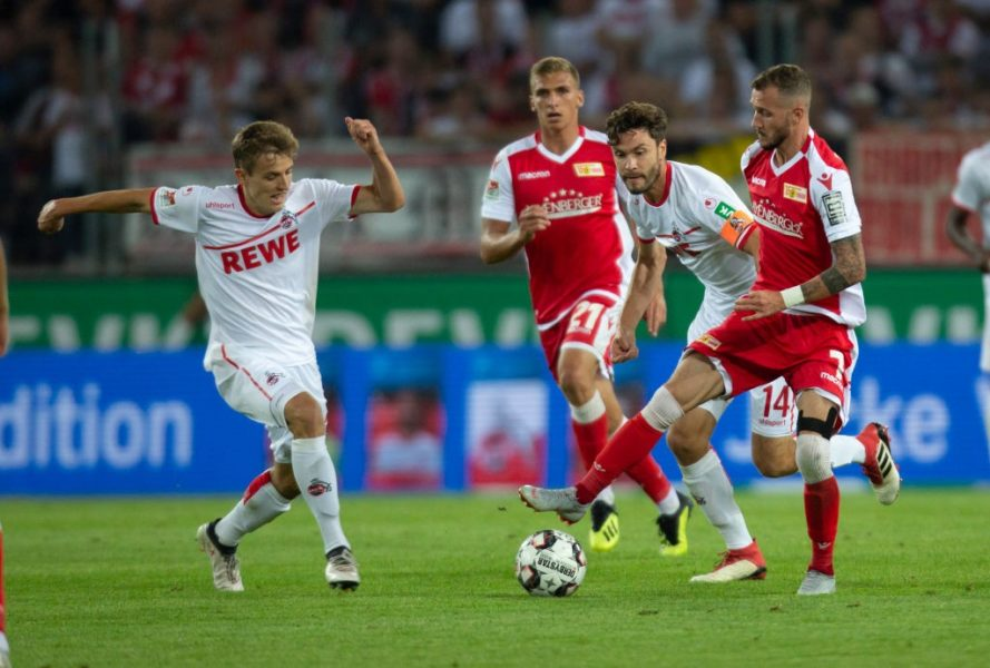 COLOGNE, GERMANY - AUGUST 13: Niklas Hauptmann of Cologne (L), Jonas Hector of Cologne (C) and Marcel Hartel of Union Berlin battle for the ball during the Second Bundesliga match between 1. FC Koeln and 1. FC Union Berlin at RheinEnergieStadion on August 13, 2018 in Cologne, Germany. (Photo by Juergen Schwarz/Bongarts/Getty Images)