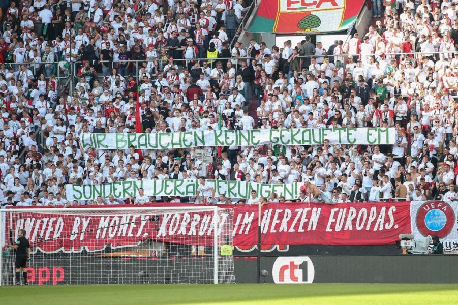 AUGSBURG, GERMANY - SEPTEMBER 22: Fans demonstrate with a banner aganist the candidation of Germany for the EURO2024 during the Bundesliga match between FC Augsburg and SV Werder Bremen at WWK-Arena on September 22, 2018 in Augsburg, Germany. (Photo by Christian Kaspar-Bartke/Bongarts/Getty Images)