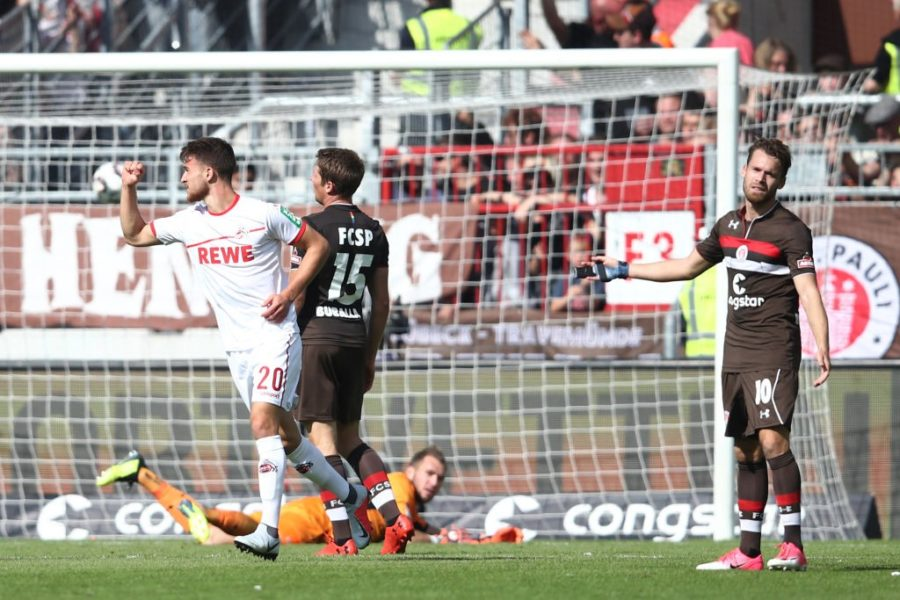 HAMBURG, GERMANY - SEPTEMBER 02: Salih Oezcan (L) of Koeln celebrates with after scoring their first goal during during the Second Bundesliga match between FC St. Pauli and 1. FC Koeln at Millerntor Stadium on September 2, 2018 in Hamburg, Germany. (Photo by Oliver Hardt/Bongarts/Getty Images