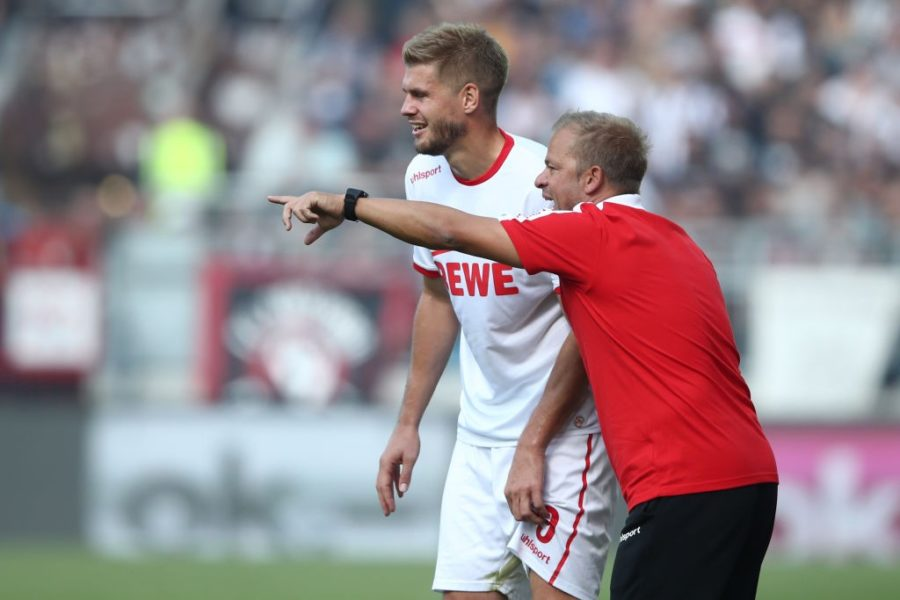 HAMBURG, GERMANY - SEPTEMBER 02: Simon Terodde and Head coach Markus Anfang (L-R) of Koeln talks during the Second Bundesliga match between FC St. Pauli and 1. FC Koeln at Millerntor Stadium on September 2, 2018 in Hamburg, Germany. (Photo by Oliver Hardt/Bongarts/Getty Images)